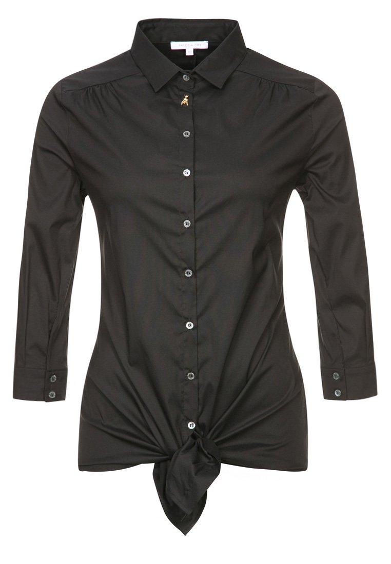 372b93d460fc En flot sort skjorte er et must have i en kvindes garderobe